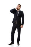 Worried businessman touching his forehead. Stock Images