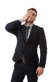 Worried businessman touching his forehead. Stock Photography