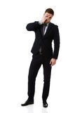 Worried businessman touching his forehead. Royalty Free Stock Images