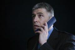 Worried Businessman Using Landline Phone Royalty Free Stock Photo