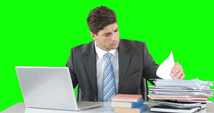 Worried businessman using laptop at desk stock video