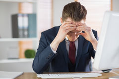 Worried businessman working at his desk Stock Photos