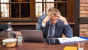 Worried businessman working in restaurant. Worried businessman working in restaurant stock image