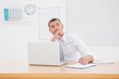 Worried businessman writing on is notepad Stock Photo