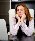 Worried businesswoman. Businesswoman looking to the laptop screen and worried about the economy stock photos