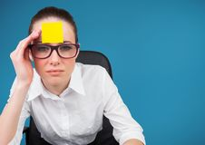 Worried businesswoman with blank sticky note on her forehead. Portrait of worried businesswoman with blank sticky note on her forehead Royalty Free Stock Images