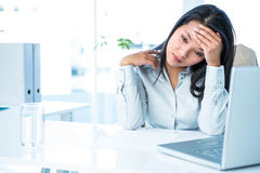 Worried businesswoman holding her head Stock Photography