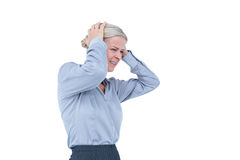 Worried businesswoman holding her head Stock Photo