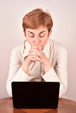 Worried businesswoman with a laptop Stock Photography