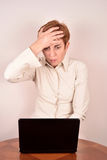 Worried businesswoman with a laptop Stock Images