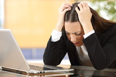 Worried businesswoman at office Royalty Free Stock Image