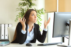 Worried businesswoman praying at office Royalty Free Stock Image