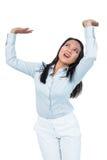 Worried businesswoman pushing something up Stock Image