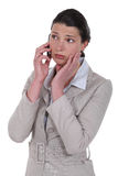 Worried businesswoman. Receiving bad news Stock Photography