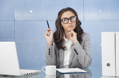 Worried businesswoman sitting at office Stock Photos