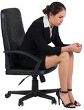 Worried businesswoman on swivel chair Royalty Free Stock Images