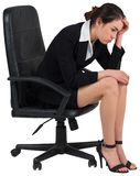 Worried businesswoman on swivel chair Stock Images