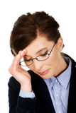 Worried businesswoman touching her head. Royalty Free Stock Photography
