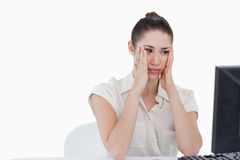 Worried businesswoman using a computer Stock Image
