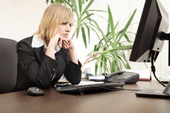 Worried businesswoman working in the office Stock Photos