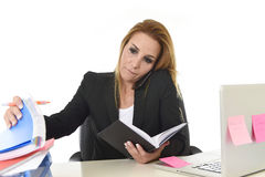 Worried busy attractive businesswoman in stress working with lap Stock Images