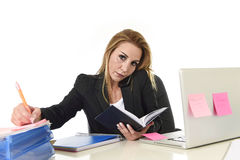 Worried busy attractive businesswoman in stress working with lap Stock Image