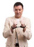 Worried caucasian business man in handcuffs Royalty Free Stock Photo