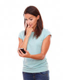Worried charming woman reading a text Royalty Free Stock Photos