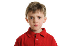 Worried child. Portrait of a 7 year old boy with worried expression isolated on white Royalty Free Stock Photo
