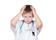 Worried child with doctor uniform Royalty Free Stock Image