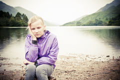 Worried child outside Royalty Free Stock Photography