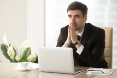 Pensive entrepreneur pondering serious problem. Worried company leader thinking about problem solution, pondering important question, frustrated because of Royalty Free Stock Image