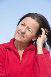 Worried concerned mature woman Stock Photography
