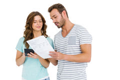 Worried couple calculating bill on calculator Royalty Free Stock Photo