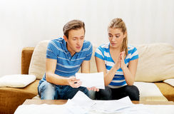 Worried couple calculating bills at home Royalty Free Stock Photography