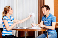 Worried couple calculating bills at home Royalty Free Stock Photos