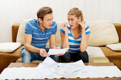 Worried couple calculating bills at home Stock Photo