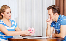 Worried couple calculating bills at home Stock Image