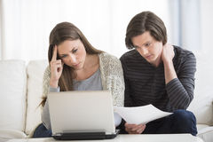 Worried Couple Calculating Finance On Laptop Stock Image