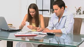 Worried couple calculating their bills stock footage