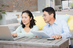 Worried couple checking bills Royalty Free Stock Photo