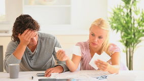 Worried couple checking at their expenses Royalty Free Stock Photo