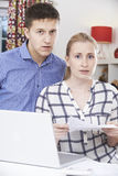 Worried Couple Discussing Domestic Finances At Home Stock Image