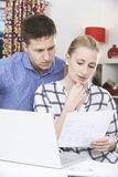 Worried Couple Discussing Domestic Finances At Home Stock Photography