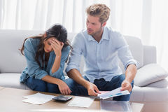 Worried couple doing their accounts. In the living room Royalty Free Stock Photo