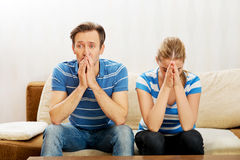Worried couple after fight sitting on sofa stock photos