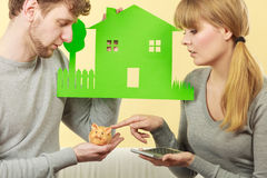 Worried couple with house. Stock Photos