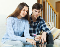 Worried couple with pregnancy test Stock Photography