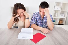 Worried couple reading paper Stock Images