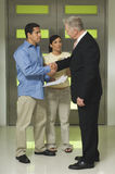 Worried Couple Shaking Hands With Advisor Stock Photos